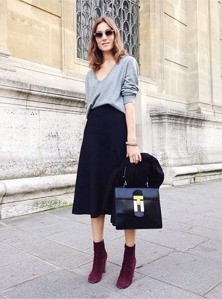Pair a grey v-neck jumper with a black midi skirt and you'll look like a total babe. Purple suede ankle boots will instantly smarten up even the laziest of looks. Shop this look for $73: http://lookastic.com/women/looks/purple-ankle-boots-black-satchel-bag-black-midi-skirt-grey-v-neck-sweater/4912 — Purple Suede Ankle Boots — Black Leather Satchel Bag — Black Midi Skirt — Grey V-neck Sweater