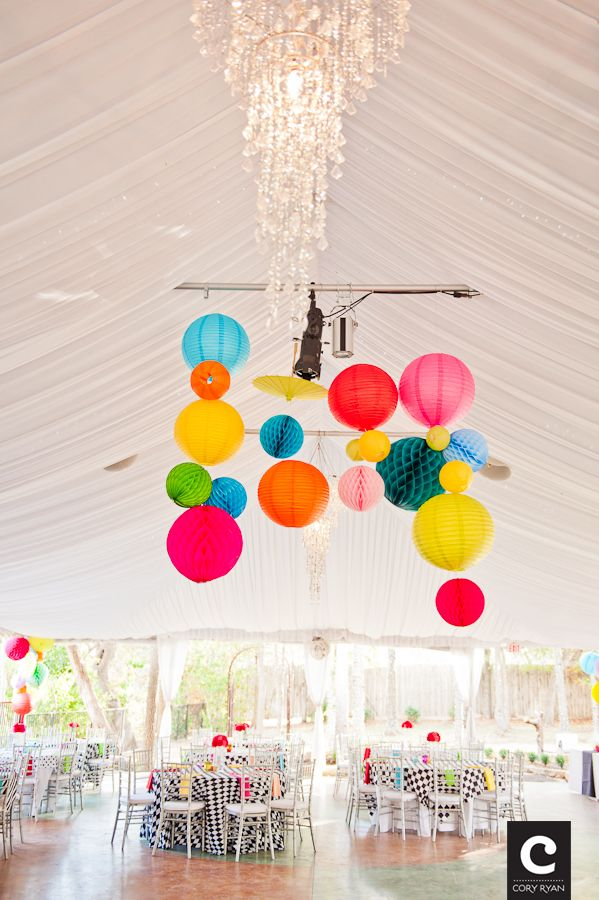 Bright lanterns are great wedding decor to add color to the white reception tent at the Hummingbird House Austin.