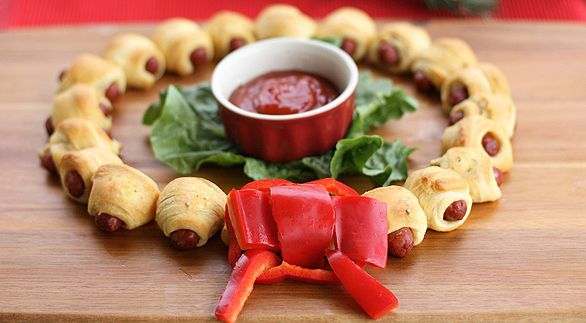 Mini Crescent Dog Wreath-Cut each triangle into three triangles, and wrap each mini sausage up in the dough.Bake.arrange them in a circle, and make your bell pepper bow.dipping sauce in center on bed of lettuce