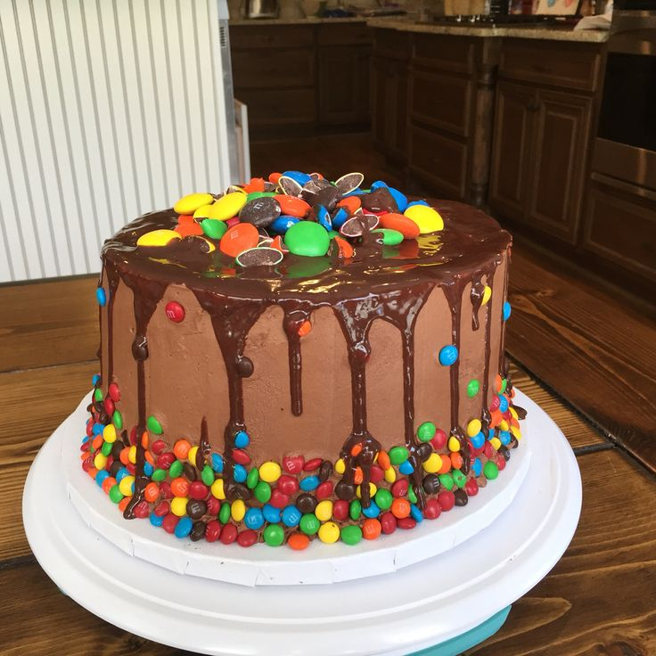 Chocolate cake with chocolate buttercream and chocolate ganache. Decorated with m&ms.