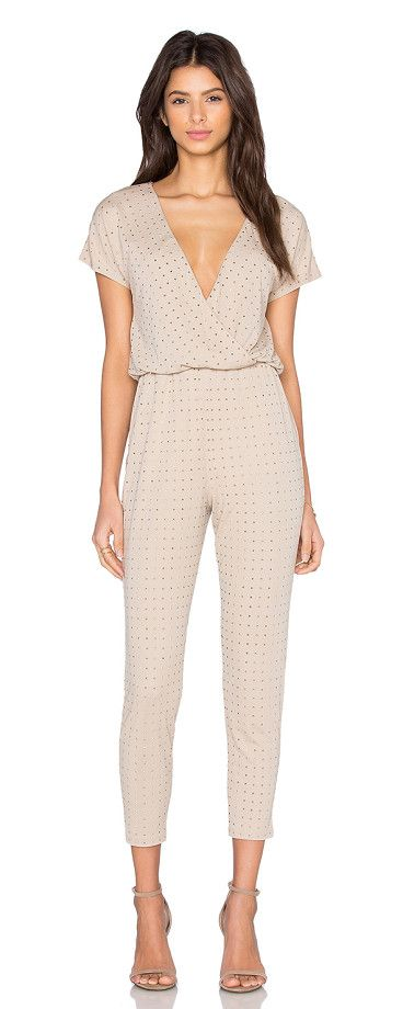 On SALE at 30% OFF! Jaxen Jumpsuit by Trina Turk. 70% rayon 30% poly. Dry clean only. Elasticized waist. Side seam pockets. Embellished detail throughout. TT-WR86. TD1...