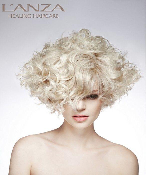 Medium Blonde curly coloured platinum white sculptured womens hairstyles for women