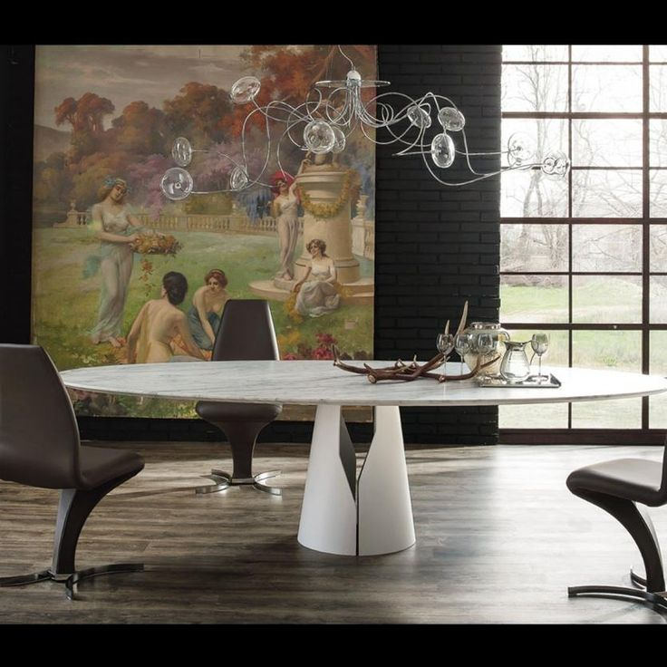 Oktopus Cattelan Italia  Oktopus is a magic and elegant light, the classic example, going well together to the handicraft technique, evocation of the past times, with a great scenic impact, fitted to prestige indoor. The aesthetic refined of Octopus is given by a interlacement of 8 or 12 fine arms in chromed metal with transparent crystal screens.  http://www.martinelstore.com/en/prod/accessories/lighting/oktopus-cattelan-italia.html