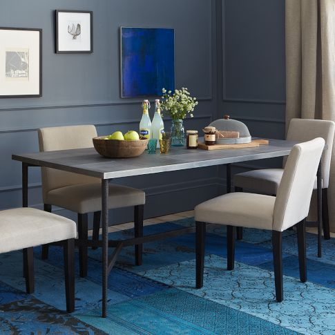West Elm cast metal table with patched metal top. I love the metal top, but would the slim build look out of place in a large room with a solid sofa?