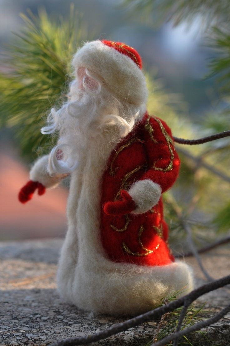 Needle felted -Waldorf Santa Claus-Waldorf inspired standing doll-soft sculpture--needle felt by Daria LvovskyFor custom orders. $49.00, via Etsy.