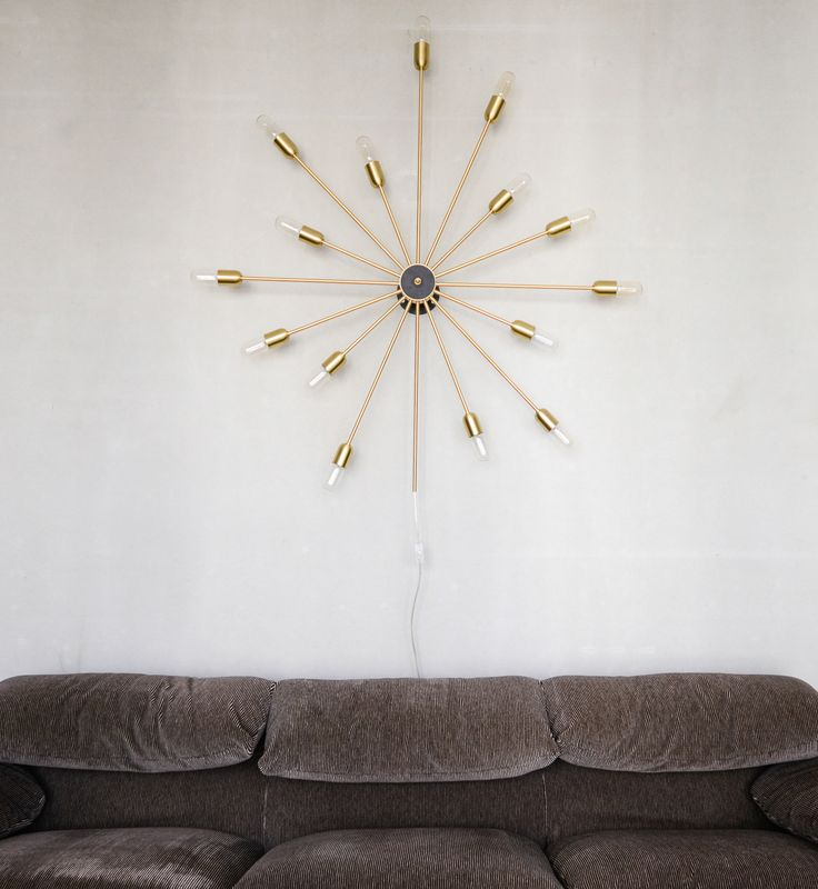 Astoria 15 arms in brass in an apartment in Berlin. Architects Studio Karhard, Photo by Stefan Wolf Lucks #rubn