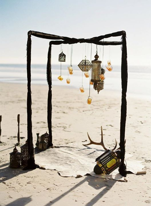 Bohemian style ceremony with lanterns.  by Sweet Emilia Jane