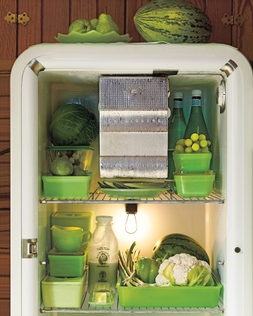 Add a little retro flair to your fridge with Jadeite food storage containers like that from Martha and Alexis Stewart's personal collection; featured in Martha Stewart Living. #retro #refrigerator #organized #mint #green #jadeite