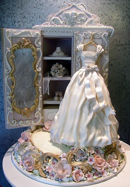 Wedding Day Gown. 3-D cake as a wedding dress and armoire. Cake is the floral base, dress and bottom drawer. Serves 150 people. Another truly magnificent cake by Rosebud's Ace, Cory