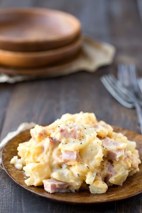 Slow Cooker Scalloped Potatoes with Ham are a yummy crock pot recipe that turns leftover Easter or Christmas ham into a whole new meal! #Christmas #ham #recipes #holiday #slowcooker #crockpot #sidedish #dinner