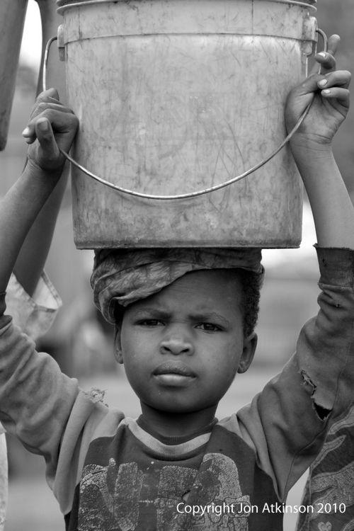 Girl with Bucket, Uganda