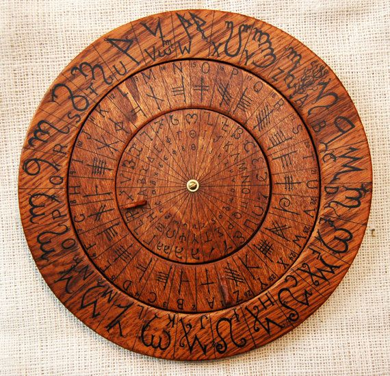 Cypher Wheel Cipher Disk Wood with Theban, Ogham, Enochian, & Celtic Rune Scripts in Black Ink, for your Secret Codes.. $99.99 USD, via Etsy.