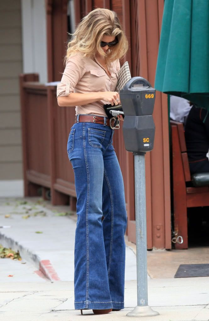 Bell bottoms are back in full swing! AnnaLynne McCord aims to elongate her figure with lengthy pants and sky high heels.
