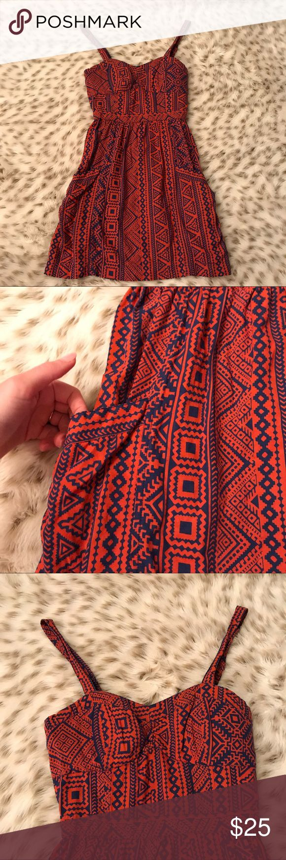 American Eagle Aztec Print Strappy Dress American Eagle blue and orange Aztec print dress! Size 2. Strappy back. Corset style top. Zip closure on side. Length is 32 inches from shoulder to hem. Excellent used condition. American Eagle Outfitters Dresses