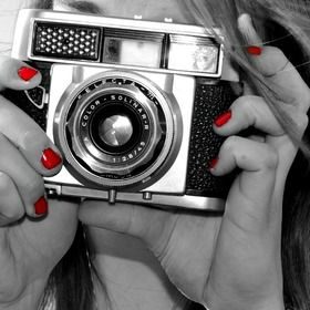 I really like that this photo is black and white but the red nails really stand out and have a great affect!