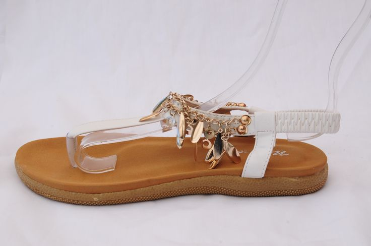 Lavish your feet with these white thong sandals with gorgeous gold-tinted embellishments. Pure #FootArt!