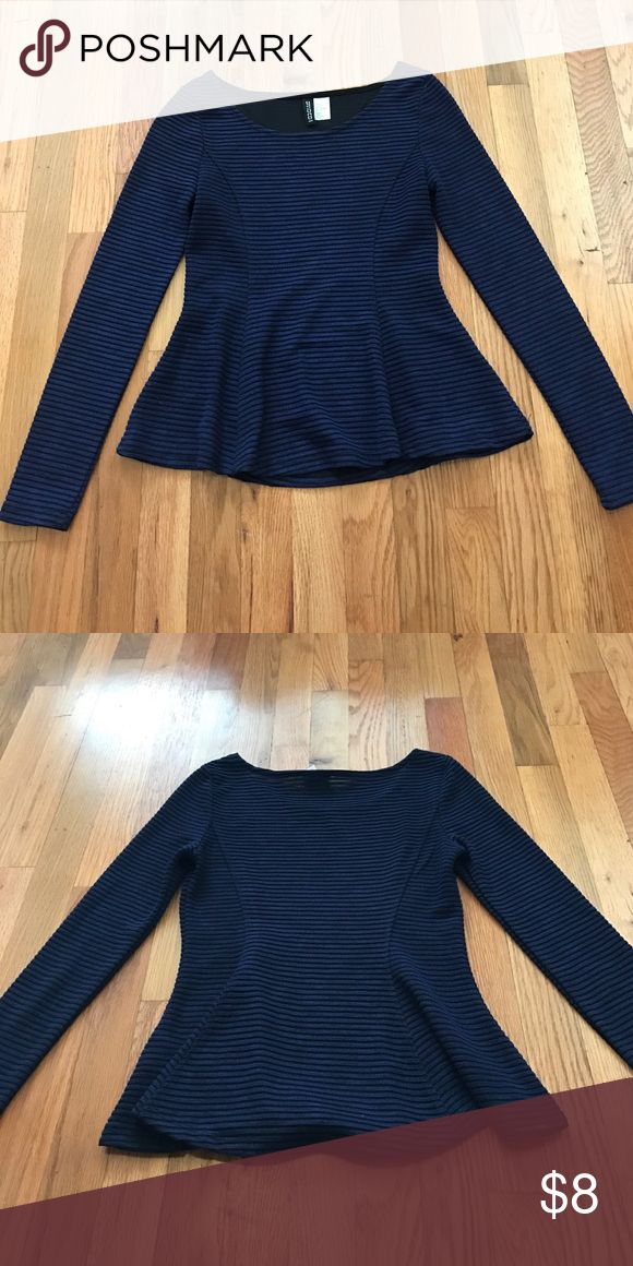 H&M navy blue long sleeve peplum top Navy blue fitted peplum long sleeve top. It has some cool texture and seaming that is very figure flattering. Note that it is form fitting through the top. Size is S but I would say it's actually like an XS. Bought brand new from H&M and only worn a handful of times. Non smoking home. H&M Tops Tees - Long Sleeve