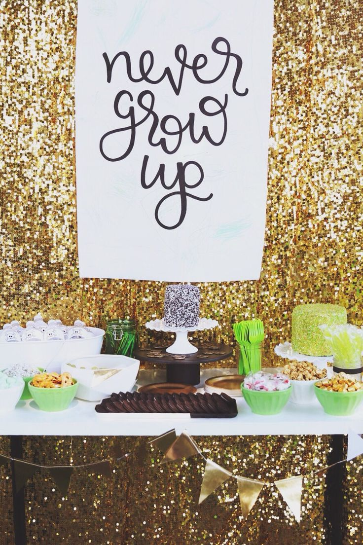 Never Grow Up! Cute backdrop for a dessert table