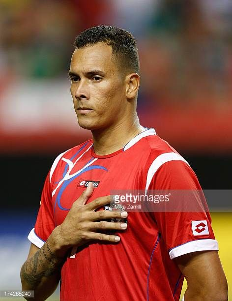 Blas Perez of Panama pauses for the national anthem before the CONCACAF Gold Cup quarterfinal game against Cuba at the Georgia Dome on July 20 2013...