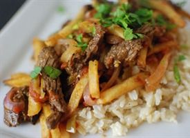 Peruvian Steak and French Fry Stir-Fry (Lomo Saltado) Only Change i would make is to make my own fries. Peruvian food is delicious !!