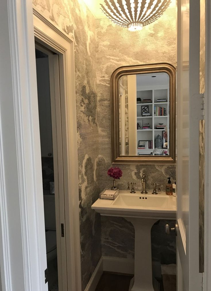 Paloma Contreras Design | Powder Bath featuring @kohlerco Artifacts Lavatory Faucet and Memoirs Pedestal Sink and Fornasetti Clouds Nuvole Wallpaper | AERIN Hampton Pendant |#whiteonwhite #kohlerideas