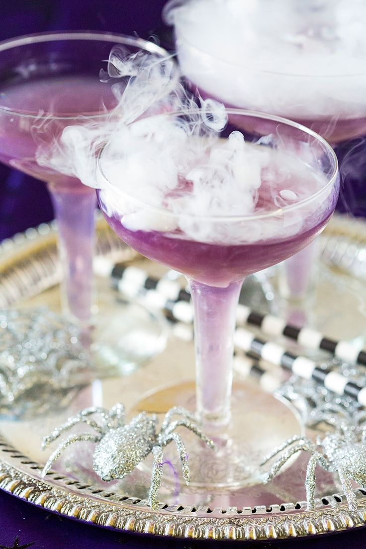 """This purple witch's brew is the perfect sassy Halloween cocktail to enjoy this October for a fantastic """"ghoul's night in""""!"""