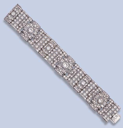 AN ART DECO DIAMOND BRACELET  The openwork geometric panels set with circular and baguette-cut diamonds, circa 1930, 18.0 cm. long, with French import marks for platinum and gold