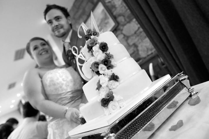 Cutting wedding cake Station house kilmessan