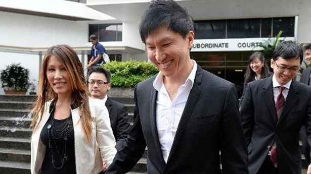 City Harvest Church Fraud Case: founder Kong Hee and his pop-singer wife Ho Yeow Sun leave court in Singapore during his fraud trial on September 9, 2013