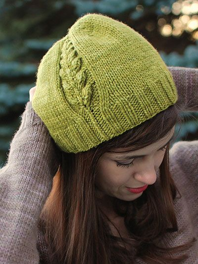 Knitting pattern for beanie hat with plant leaf motif on side Perennial Hat Knit Pattern at Annie's (affiliate link)