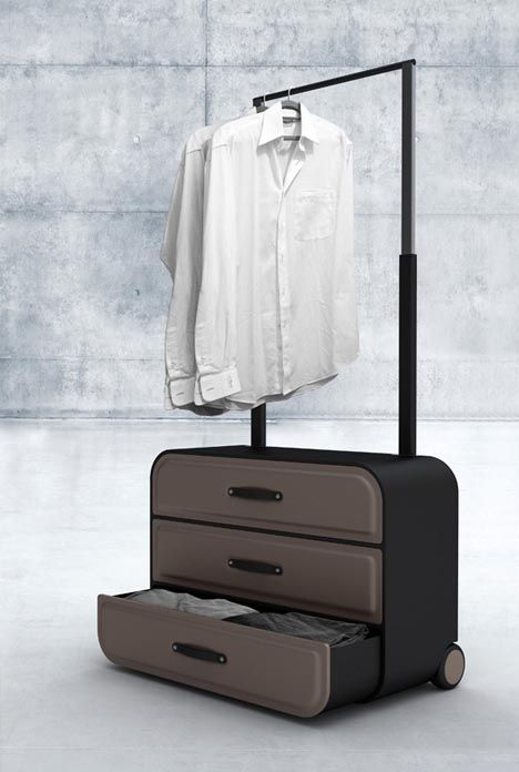 A series of dresser-style drawers that simply slide out of the front of the suitcase, and a pull handle that doubles as a hangar-friendly bar