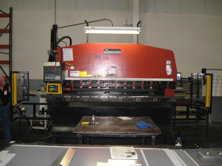 Amada RG Press Brake with ISB Merlin Safety Package installed with special brackets. Brackets allow for bending parts over end of tooling. Details: http://www.isblite.com/index.php
