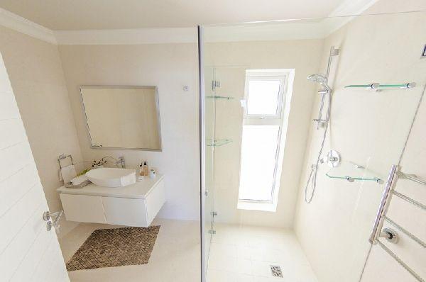 White, beach style modern bathroom built by RenoFix, Cape Town