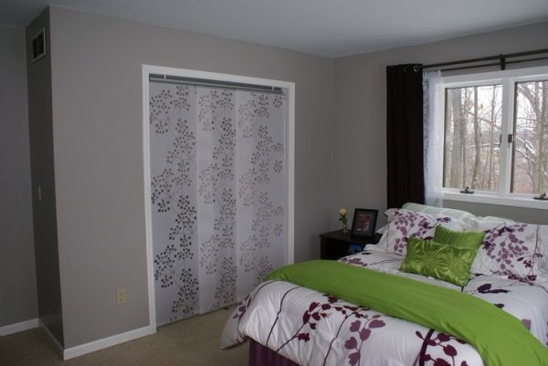 Ikea panel curtains as closet doors.