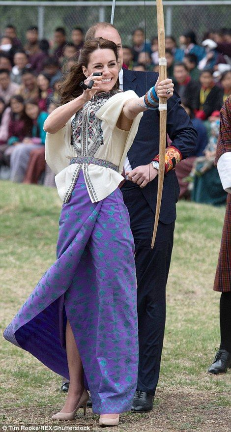 Taking aim: The Duchess of Cambridge tries her hand at archery,Bhutan's national sport, on the royal couple's visit to the kingdom