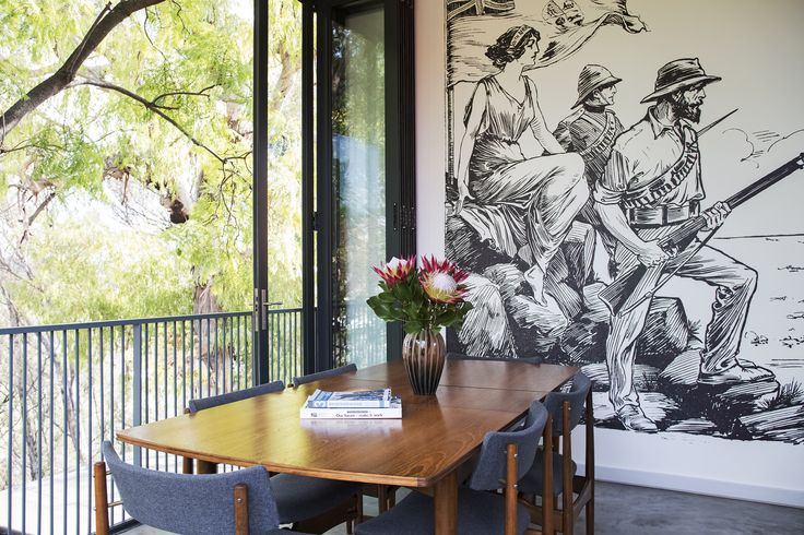 The mural is an enlarged cartoon by Denis Santry, the original owner of Kleine Schuur. The table and chairs are from Vintage Cowboys.