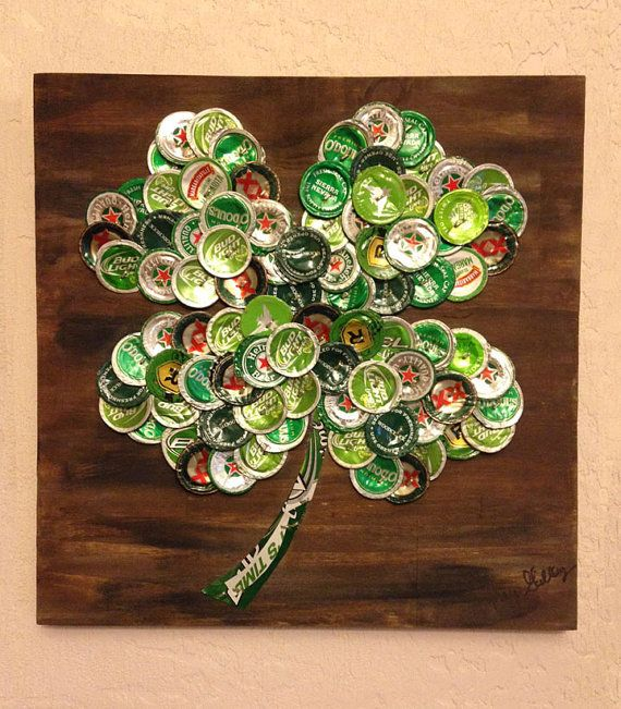 This piece has sold but I will make another one just for you!  Show off your Irish side! This piece titled Lucky is a four-leaf clover created from flattened green beer caps mounted on a painted piece of wood. Beer brands included are Heineken, Bud Light Lime, ODouls, Woodchuck, Michelob Ultra Cider, Smirnoff and many more.  Piece measures approx. 12 wide X 12 tall X 1/2 deep. It is signed both front and back, titled and dated - ready to hang!  Display in a bar area to create a conversation…