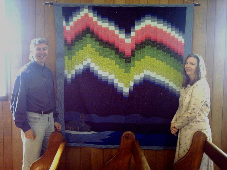 This bargello quilt of the aurora borealis and the church is hanging in Our Lady of Sorrows in Fond du Lac, SK.  I am pictured here with (then) Fr. Murray Chatlain, now Archbishop  of Keewatin-LePas.
