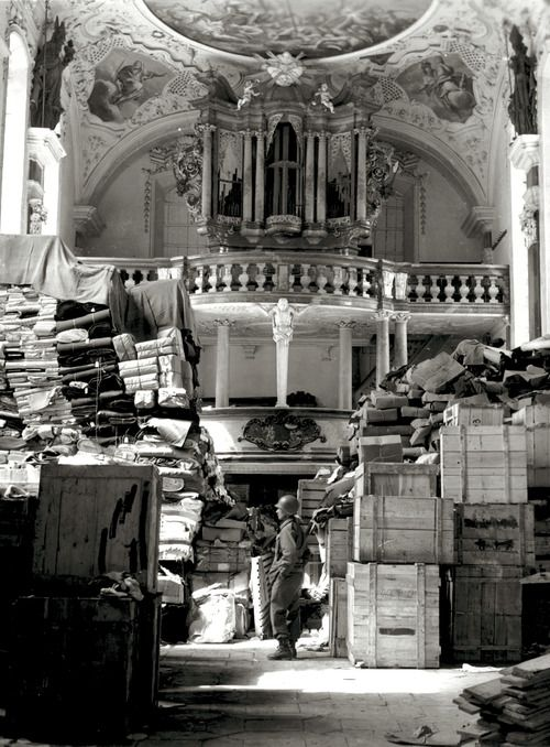 A soldier inspects a church stored with the stolen art of Europe. Elligen, Germany, 1945.