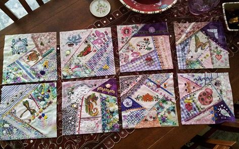 Crazy Quilt Block with my own centre block designs , painted ( acrylic) and heat set  . Still have to finish these off into a table runner