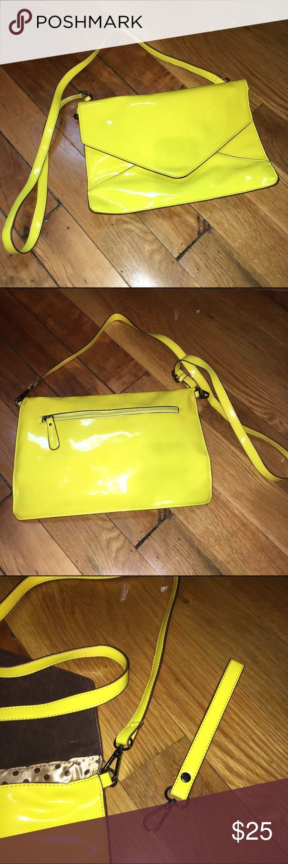 Neon yellow envelope purse. Neon yellow envelope purse. Includes long cross body strap and wristlet strap. New. Patient leather. Pockets inside and outside. About the size of an iPad. 13 in x 9 in. Melie Bianco Bags Crossbody Bags