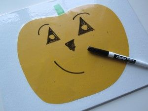Cut and paste a pumpkin on paper, laminate with contact paper, use a dry erase marker to make pumpkin faces