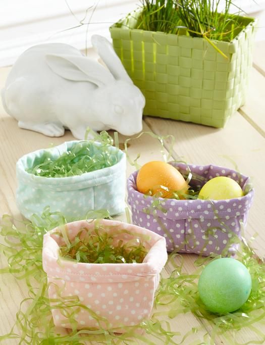 Festive little fabric baskets are perfect for holding a few treats, a duet of colored eggs, or other seasonal favors.