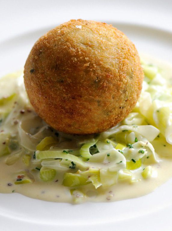 This smoked haddock fish cake recipe from Dominic Chapman is served with a sumptuous portion of creamed leeks