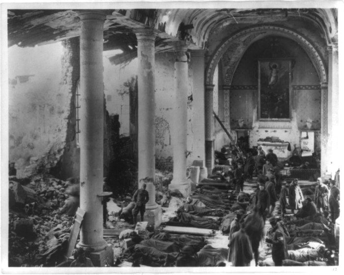 An American army field hospital inside the ruins of a church in France during World War I. France, 1918