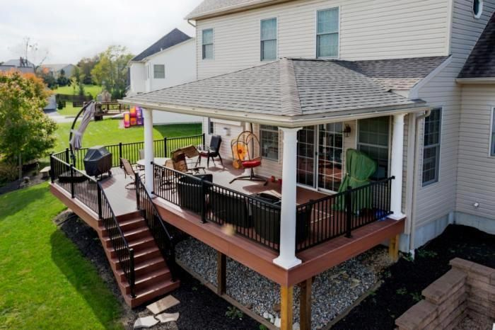 Among The Great Ways To Bring Your Lawn To Life With Flashes Of Color Nature S Music And Amusement Is T Porch Roof Design Decks And Porches Patio Deck Designs