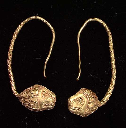 A PAIR OF GREEK GOLD EARRINGS, ca. 4th-3rd century BC. With twisted loops and detailed lion head terminals.