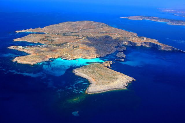 Comino Island  is an island of the Maltese archipelago between the islands of Malta and Gozo in the Mediterranean Sea, measuring 3.5 square kilometres (1.4 sq mi) in area. Named after the cumin seed that once flourished in the Maltese islands.