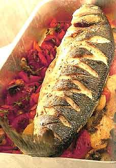 Baked Sea Bass with Roasted Red Peppers, Tomatoes, Anchovies, and Potatoes ( from Rick Stein: Complete Seafood Cookbook)