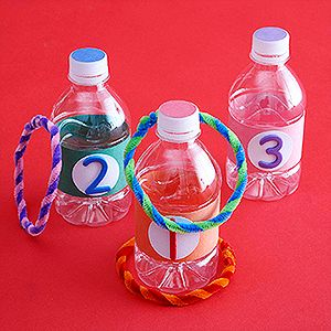 Fun indoor games! chenille stems and water bottle = ring toss